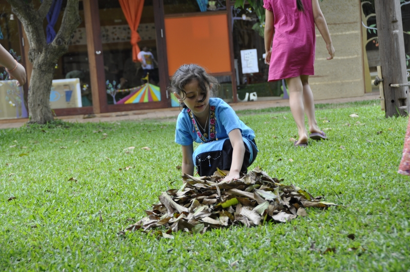 Panyaden student picking up dry leaves at school in Chiang Mai