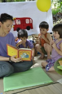 Panyaden School teacher reading story to children at Yoga Mala 2011