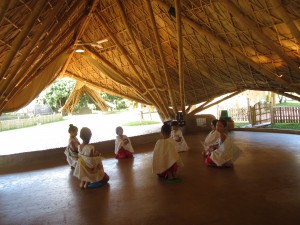Students in Panyaden's bamboo and earth assembly hall.