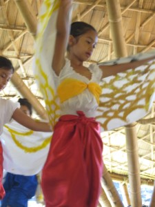 Arms raised like a bird - student dancer at Panyaden School