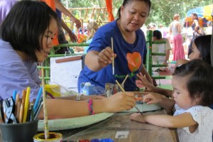 Painting with children: Panyaden School teachers at Yoga Mala Festival, Thailand