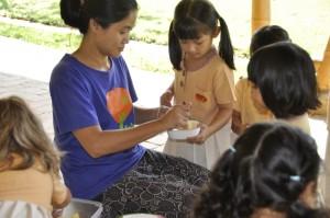 Primary class teacher with Panyaden School pupils