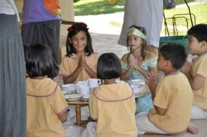 Students giving thanks for food, Panyaden School