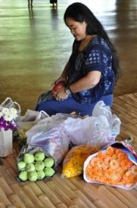 Panyaden School art teacher preparing flowers for making kratongs with students