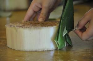 Pinning banana leaves around krathong base made of banana stem (Panyaden School)