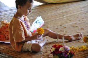 Caucasian student at Panyaden School making his own krathong