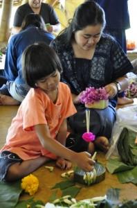 Teacher and student making krathong flower floats, Panyaden School