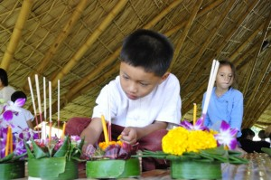 Little boy making his krathong at Panyaden School