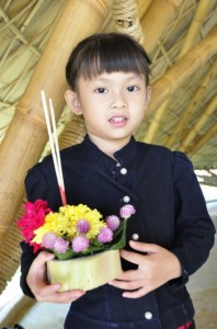 Panyaden School student with traditional float (kratong) for the Loy Krathong Festival