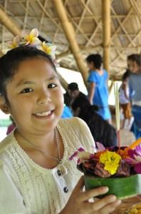 Panyaden School studenr showing off her hand-made krathong