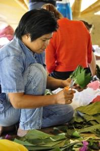 Thai music teacher cutting up banana leaves for krathong-making (Panyaden School)
