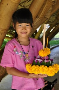 Girl (student of Panyaden School) with the large krathong that she made at school