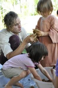 Getting hands dirty to help make EM Balls at Panyaden School