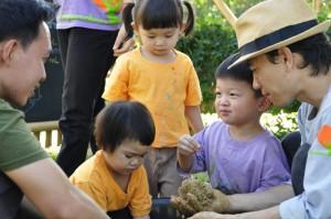 Young nursery and kindergarten students shaping lumps of EM Balls at Panyaden School