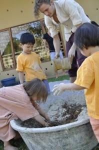 All hands on deck! Nursery students making EM balls at Panyaden School