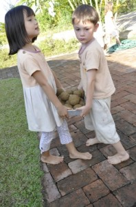 Nursery students of Panyaden School carrying in their finshed Em balls to the school assembly hall