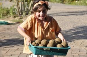 Panyaden Primary School student with her load of EM Balls