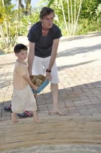 Parent helping young kindergarten student with load of EM balls at Panyaden School