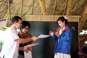 Panyaden student receiving certificate for completing charity run