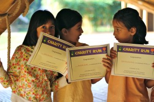 Panyaden primary students show off their running certificates
