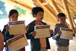 Primary students of Panyaden School with their running for charity certificates