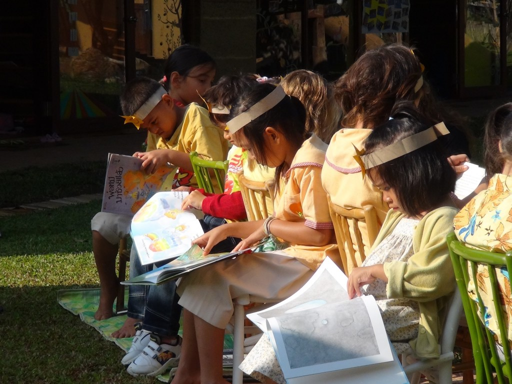 Panyaden School students reading outdoors