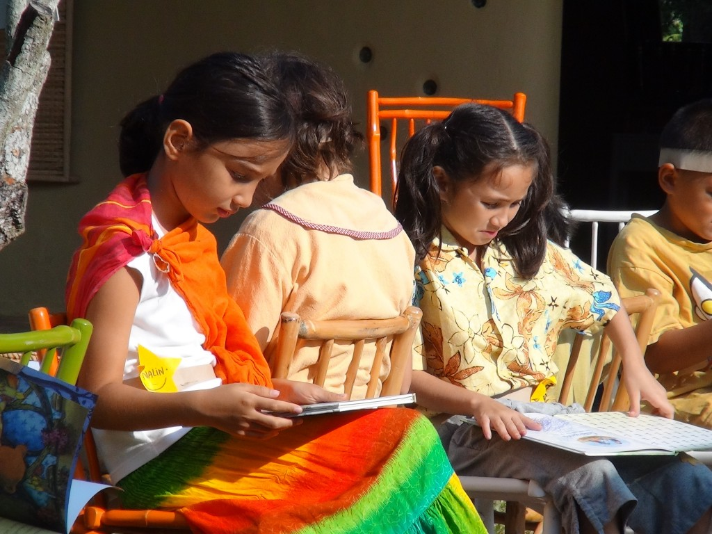 A quiet read under the shade at Panyaden School
