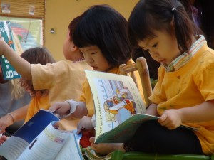 Young students reading outdoors at Panyaden School