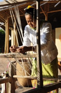 Preparing cotton yarn for the loom before weaving. Cotton project by Panyaden School
