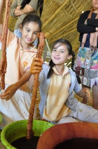 Primary students of Panyaden School trying their hand at dyeing cotton