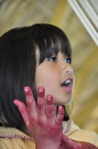 Pink stained hand of student at Panyaden School