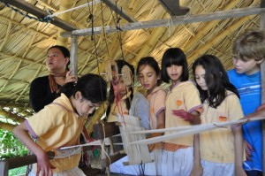 Panyaden School students weaving cotton yarn on the loom