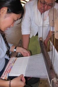 Panyaden School teacher weaving cotton fabric