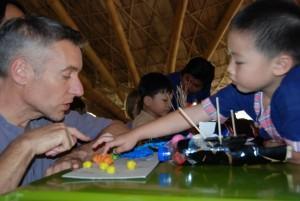 Kindergarten student sharing his project with Panyaden School Director