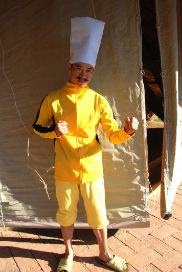 Panyaden School teacher in chef's costume as part of role playing