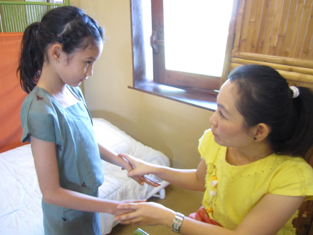 Primary student undergoing basic health screening at Panyaden School in Chiang Mai