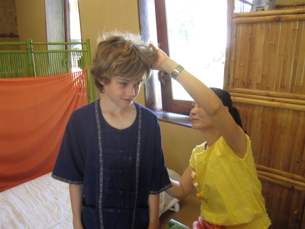 Checking hair during health screening at Panyaden School