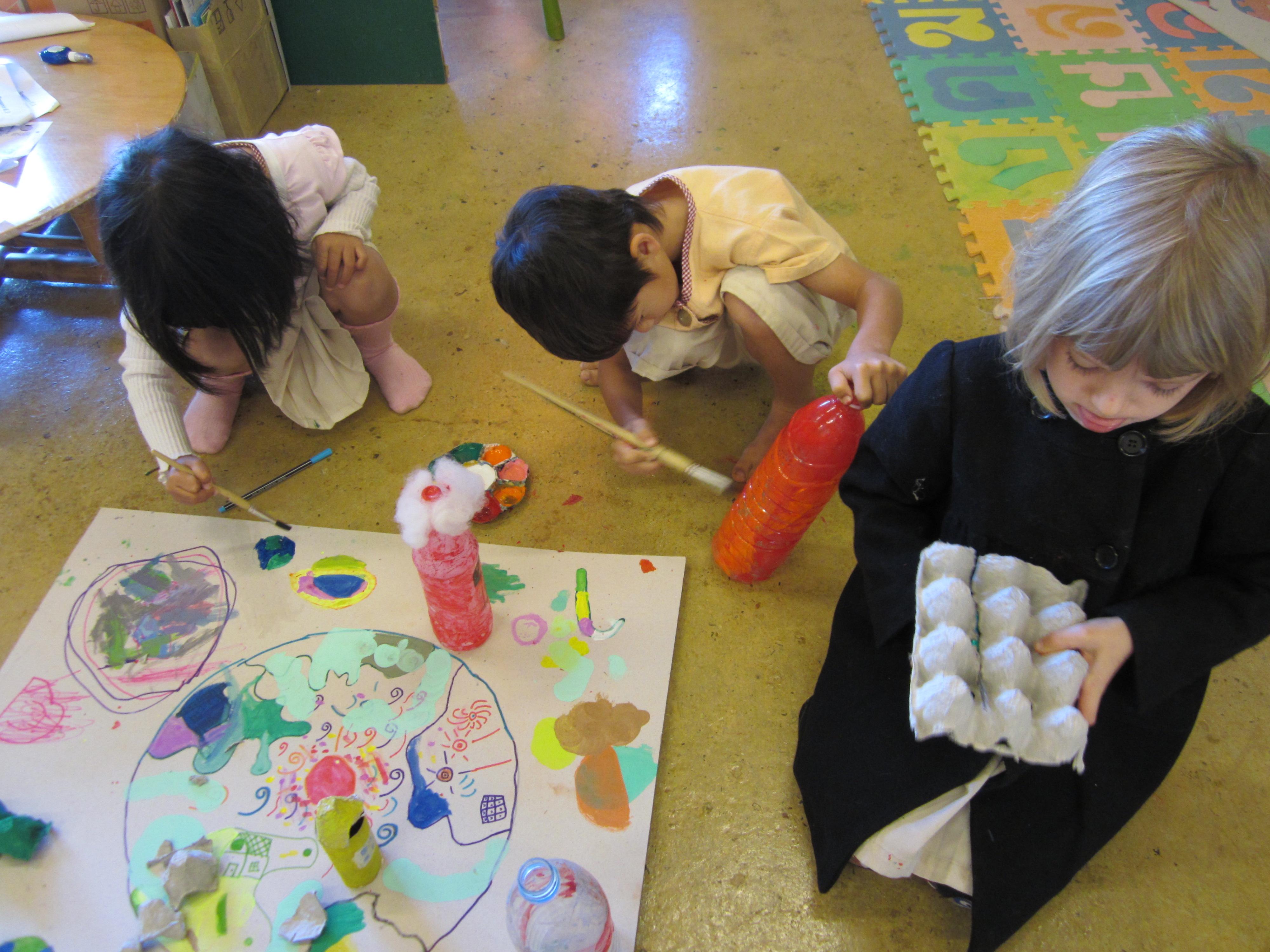 Kindergarten students making art with recycled materials at Panyaden School, international school in Chiang Mai