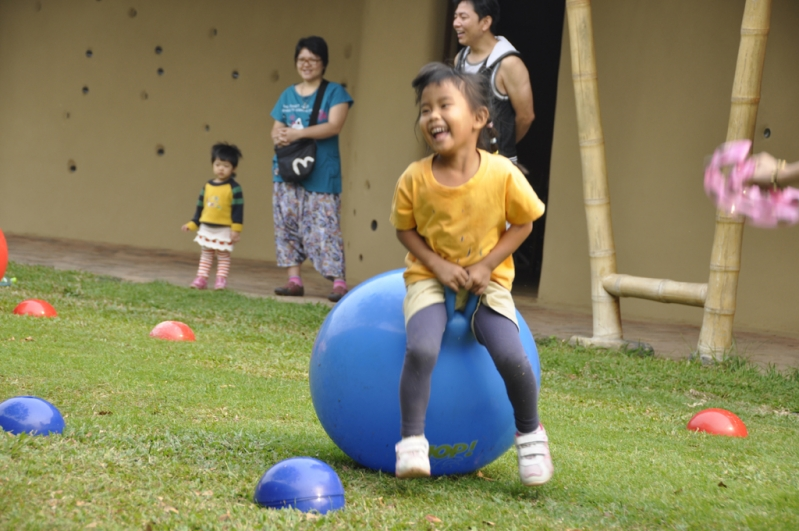 Student enjoying bouncing game at Panyaden School Sports Day 2012, Chiang Mai