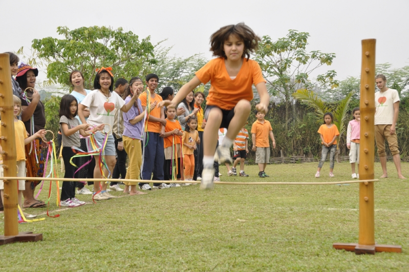 Panyaden student clears the pole at high jump event on Sports Day