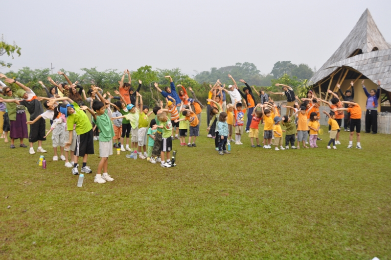 Aerobic exercise warm-up before start of Sports Day at Panyaden School in Chiang Mai