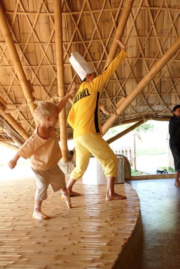 Here we go! Panyaden School's teacher with kindergarten student demonstrating a kung fu move