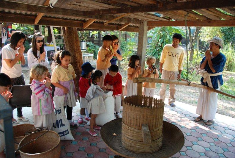 Students of bilingual school, Panyaden at a rice mill