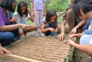 Panyaden School summer school students planting at the botanic garden
