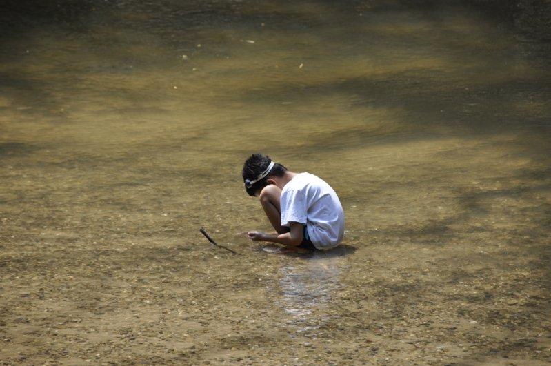 Quietly looking for rocks - student on Panyaden Summer School field trip