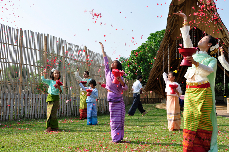 Dancers tossing rose petals in the air at Panayden School, bilingual school in Chiang Mai