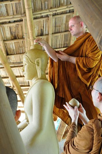 Panyaden School's spiritual advisor, Taan Ajahn Jayasaro, enshrining relics at our Buddha image