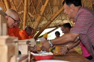 Panyaden School guest from Hang Dong municipality offereing food to monk at our school's opening ceremony
