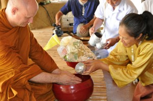 Panyaden School Founder pouring water for Taan Ajahn Jaysaro (part of food offering ritual at school's official opening day)