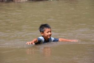 Boy enjoying a swim during field trip, Panyaden Summer School